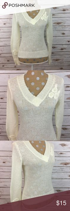 Cream Fitted V-Neck Sweater Cream fitted v-neck sweater with flower detail. Super soft with beautifully stitched flower details. 53.2% Acrylic 15.4% Mohair 32.4% Nylon   🚫 NO TRADES 🌟 POSH Rules Only 🌟 🎉 Customized Bundle Discounts 💋 💗 Offers please use offer button below 🔻 Wet Seal Sweaters V-Necks