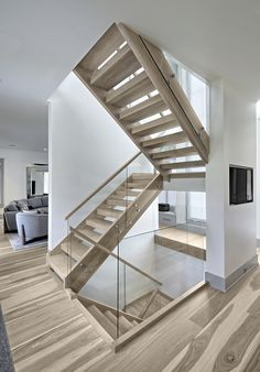 Open staircase with glass balustrade Open staircase with glass balustrade Two-story foyer with open riser stair with 3″ thick box treads , 2-1/2″ x 12″ curb stringers, 3″ square posts, and rectangular handrails all in white oak spanning 3 stories Open staircase with glass balustrade Open staircase with glass balustrade #Openstaircase #glassbalustrade