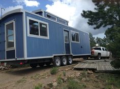The Blue Caboose tiny house: a 240 sq ft home on wheels, designed and built by Tiny Diamond Homes.