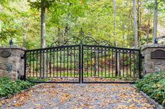 Gorgeous custom swirl and scrollwork for a wrought-iron driveway gate. A beautiful driveway design look. Stone Driveway, Driveway Design, Railing Design, Gate Design, Wrought Iron Driveway Gates, Gates Driveway, Entrance Gates, House Entrance, Driveway Materials