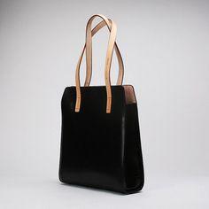 https://www.etsy.com/listing/187675007/handcrafted-minimalist-leather-shoulder? NAME: Handcrafted Minimalist Leather Shoulder Bag etpts006 MATERIAL: vegetable tanned upper leather SIZE: height 35cm, length 32.2cm, width 10cm COLOR: primary color, black, golden brown INNER STRUCTURE: 2 inner pockets, 2 zipper pockets