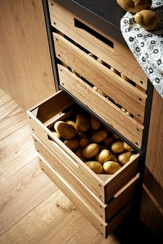 Plan your kitchen with all-round carefree service at Spitzhüttl Home Company - Potatoes and onions find their place in the oak wooden drawers. More ideas at Spitzhüttl Home Comp -