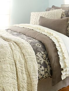 Love the cozy layers of bedding