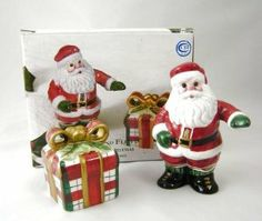 """Fitz and Floyd 2003 Plaid Christmas Santa and Gift Salt and Pepper Shakers - 2063/239 by Fitz and Floyd. $20.00. 3.5"""" H. Handcrafted China. 2003 Plaid Christmas Santa and Gift Salt and Pepper Shakers - 2063/239. Salt and Pepper Shakers"""