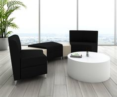 Modern waiting area featuring an elegant Solid Surface Drum from Nevins. Waiting area also features: Nevins indoor planter and Nevins Synk2 modular lounge seating.