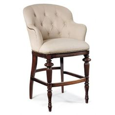 Our handcrafted Boswell Barstool offers the comfort of an upholstered armchair in the shape of a barstool. The tufted leather seat and roll arms have a decidedly English flair that's befitting for a finely outfitted pub. Available in your choice of all fabric, all leather, or a designer fabric/leather combination. Crafted of solid birch, with a cornerblocked frame and artistically reeded and turned legsThe cushion is firm yet has just enough give for optimum comfortLightly distressed…