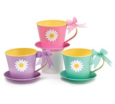"""#burtonandburton Tin spring teacup/saucer planter with white daisy and yellow interior. Satin bow on handle to match color. PVC liner included.<br><br>4 1/2""""H X 7""""W X 6 1/4""""D X 5""""Opening. Saucer: 6 1/4""""DIA.<br>2 assortments of 3."""