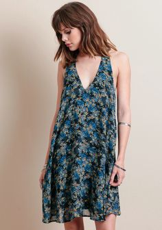 this adorable floral mini dress with a v-neckline is just sexy enough to wear from day to night.