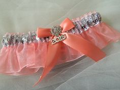 An elegant prom garter silver sequences and coral organza- This garter set is embellished with a satin bow and 2015 charm, centered with a sparkling rhinestone .  ~~~ ~~My wedding garter are made-to-o