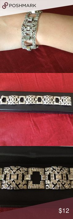 Bracelet Beautiful silver and cubic zirconia diamond bracelet. This bracelet can dress up any outfit. The last picture is of the back of the bracelet. Comes in black box. Jewelry Bracelets