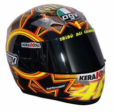 2004 - This was Rossi's Mugello helmet designed to poke fun at his recent results which saw Rossi miss the podium on consecutive occasions for the first time since his first premier class win for Honda in 2000. Rossi said that the story behind the design was steeped in Italian tradition, where the saying goes that if you take 4th place – then you get the wooden medal.