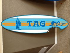 """wall hanging surf board surfboard decor hawaiian beach surfing beach decor. You are bidding on a custom made themed surfboard decor... It is made of high quality 1/2"""" plywood painted and vinyl graphiced. I put 2 coats of gloss clear coat to give it a beautiful shine to it... Pick a name or saying to go on the board. This name can be changed to anything.. for custom work please contact me let me know what you want and i can list it and send you the link. I also send you a proof of your…"""