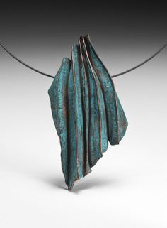 "Sandra Zacharia ""Colorformed Wave"" Necklace. Bronze, colored pencil, oxidized sterling silver neck cable Fabricated, fold-formed, patinated; 3-3/5"" X 2"" X 4/5"""