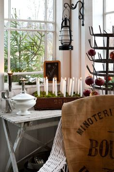 What a gorgeous idea for advent... 24 candles! I'd have them surrounding one big pillar in the middle for Christmas Day :D --- Vintage House: VÅR GLASVERANDA I UNDERBARA JULHEM
