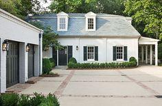 painted white brick, black trim, brick lined driveway