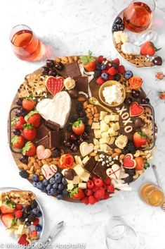 This Chocolate and Cheese Dessert Board is the absolute best! Dark chocolate, homemade sugar cookies, nuts, fresh berries, + cheeses. What could be better?! Perfect for Valentine's Day, anniversaries, date night, parties, get togethers, or even just as a little treat for yourself. There is no wrong way to enjoy this amazing board.
