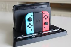Nintendo Switch Dock for Table https://www.amazon.com/FancyWolf-Nintendo-Switch-Organizer-Joy-con/dp/B071HT4JHP/ref=sr_1_1?ie=UTF8&qid=1496623484&sr=8-1&keywords=nintendo+switch+dock
