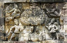 Kalpataru, the divine tree of life being guarded by mythical creatures Kinnara and Kinnari, flying Apsara and Devata. 8th century Pawon temple, Java, Indonesia.