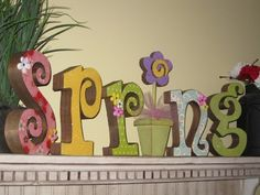 Could either paint each letter or cover each one with scrapbook paper and seal with Mod Podge.  Cute!!