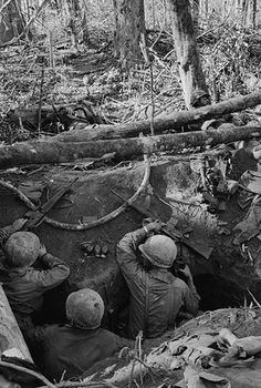 27 Nov 1967, Near Dak To, South Vietnam - Under Fire. American soldiers move carefully from a trench to rescue a wounded colleague (background) during fighting at Hill 875. The summit was finally captured by U.S. forces after some of the bloodiest fighting of the Vietnam War. N. Vietnamese troops poured heavy mortar fire on an artillery base near Dak To and the Special Forces camp in Kontum, 40 miles to the South. - Image by © Bettmann/Corbis