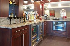 Can we talk about how a bar is required in any self-respecting finished #basement? This is a stellar example of one!