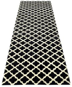 Contemporary hand tufted luxury wool rug in ivory white and jet black, created as a runner using the 'Earl' design.