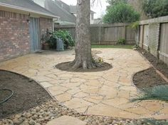 Flagstone patio with river rock aggregate and dry creek bed drainage.