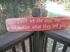 "This funny dog sign goes great with your primitive rustic home decor, it is made of wood and hand painted to give a distressed aged look. Sign measures 26"" X 5 1/2 "" It comes ready to hang with a hang"