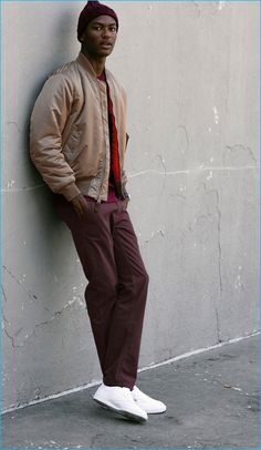 Model Hamid Onifade sports a bomber jacket with burgundy pants from JackThreads.