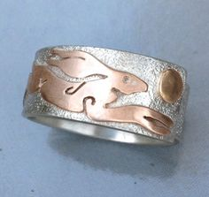 red gold hare on silver ring