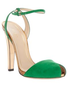 Green suede sandal from Gucci featuring a peep toe, a leather sole, a gold-tone metallic trim and tapered heel and an ankle strap with a side buckle fastening.