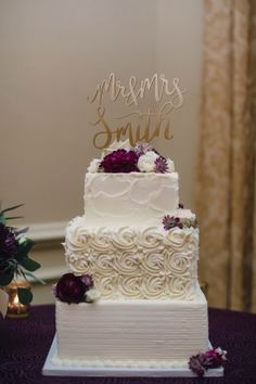 rosette wedding cake, square buttercream wedding cake, purple wedding cake, monogram cake topper, gold cake topper from purple jewel toned romantic Riverbend Golf and Country Club Virginia wedding with Kristen Gardner Photographer