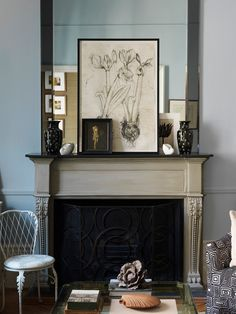 Designer Colette van den Thillart uses a large mirror as a backdrop and then displays a rotating gallery of artwork in a casual way by propping smaller pieces in the front. Living Room Mirrors, Living Room Modern, Home Living Room, Living Room Designs, Living Room Decor, Mirror Over Fireplace, Fireplace Mantels, Fireplaces, Mantles