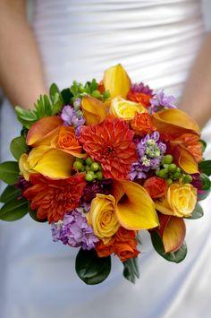 Beautiful fall wedding bouquet. Calla lily, roses, hypericum berries, dahlias. (Photo Freedom Flashing Photography)
