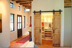 Love barn-style door openings. Find a pair of antique doors or shutters and adapt as Sally Wheat (of Sally Wheat Interiors) did in her Santa Fe home. More photos at the delightful blog, Cote De Texas.