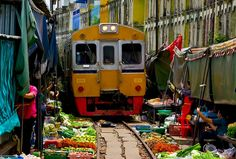 This is the Maeklong Market, west of Bangkok, a decades old place of trade in Thailand. Vendors were so comfortable here that when the Maeklong Railway built a commuter train to Bangkok running right through the middle of their market, they stayed right where they were. Watch the video of how the market makes way for the train which comes through 8 times a day. Video via link