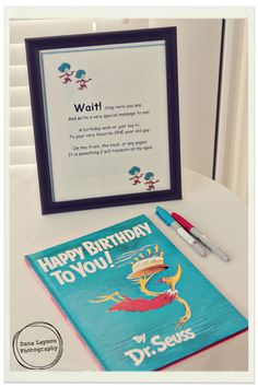 Such a cute idea for a one year birthday party! Dr. Suess Happy Birthday to you - autograph the book!