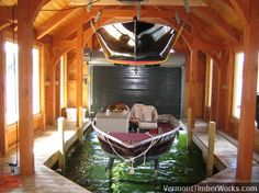 Like this idea of rental boat lifted up high, making room for client owned boat.