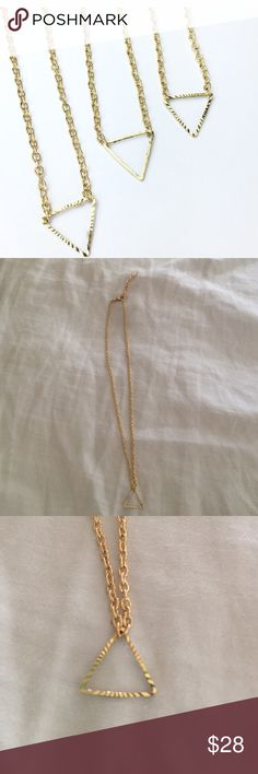 Gold Triangle necklace 14 k gold metal alloy. Measures 18 inches with expandable clasp. Wila Jewelry Necklaces