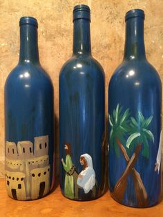 Nativity Story painted Wine Bottles set of 3 by EsPaintingsNThings Wine Bottle Trees, Old Wine Bottles, Recycled Glass Bottles, Wine Bottle Art, Painted Wine Bottles, Wine Bottle Crafts, Paper Ornaments, Snowman Ornaments, The Nativity Story