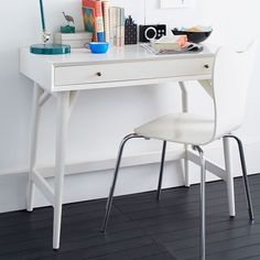 We designed this mini version of our best-selling Mid-Century Desk for those without a lot of extra space. Crafted of FSC®-certified wood and finished on all four sides, you could even float it in a room's center.