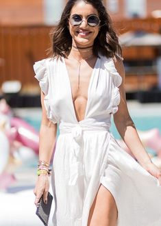 Best Coachella Festival Outfits 2017 | Plunging neckline, white wrap dress with ruffles