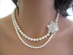 Vintage Inspired Swarovski Pearl and Crystal Bridal Double Strand Pearl Necklace with Flower Rhinestone Brooch Bridal Jewelry. $65.99, via Etsy.