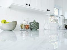 Marble is a rock that forms when limestone is subjected to the heat and pressure of metamorphism, it is composed primarily of the mineral calcite. After being sanded with progressively finer abrasives, marble can be polished to a high luster. White Marble Kitchen, Black Kitchen Faucets, Granite Kitchen, Kitchen Countertops, Colorful Kitchen Decor, White Kitchen Decor, Black Quartz Countertops, Farmhouse Style Kitchen, Black Kitchens