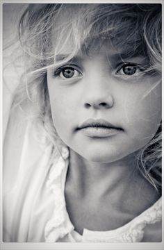 I have no idea why this picture moved me. Maybe it was the innocence, serenity, or just how the photographer captured this beautiful little girl.