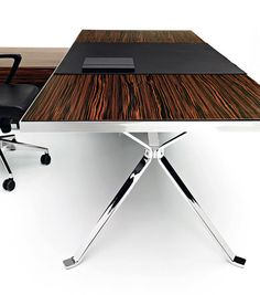 Executive desk.  not sure how I feel about this desk - it just caught my eye. Maybe too stark?