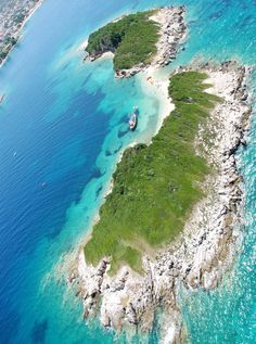 Ksamil, Saranda, Albania I have been there. It is the las unspoilt coastline left in Europe. Probably what the south of France was like at the turn of the 20th century. Go before it gets ruined!!! The southern part of Albania is magnificent. Great food, nice people and very inexpensive.