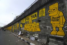 Riyan Riyadi alias the Popo, 2013, mural at Pasar Pagi Asemka Overpass, West Jakarta. Photo: Agung 'Abe' Natanael. Image courtesy Jakarta Biennale.