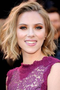 "Scarlett Johansson proves that adding texture to a short, choppy cut is especially alluring. ""Instead of doing the obvious—amplifying her dress with flashy jewelry, a beehive updo, and lots of makeup—we pared it down,"" says hairstylist Duffy of Johansson's Oscars look. Using a medium-barrel curling iron and sea-salt spray, he whipped the actress's locks into sexy waves, alternating the direction of the curl for each section and leaving ends straight ""for an organic, natural appearance.""…"