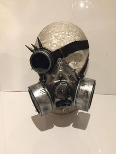 Steampunk Respirator Spikey Gas Mask And Spikey Goggle Monocle, Post Apocalyptic Survival, Mad Max, Burning Man Wasteland Style. Details: This listing is for a steampunk gas mask and retro monocle combo with rustic silver distressed finish, Mad Max, futuristic, post apocalyptic,